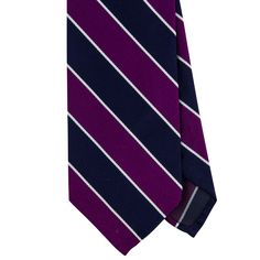 Exquisite Trimmings | Accessories | Ties | Purple Navy Wide Striped Silk Rep Tie For over 15 years, from a small workshop in Naples, E.G. Cappelli has been producing some of the finest and most unique neckwear in the world. This tie is a classic striped rep in a tasteful colour palette. 100% Silk 3 Fold Colour: Purple and navy Dry Clean Handmade in Italy