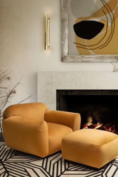 For a holiday season, living room decor that is warm and cosy but still modern and bright combine the super comfortable OTTER Single Sofa and Ottoman with the cool CAUCA Rug and the impressive CYRUS Wall Light.