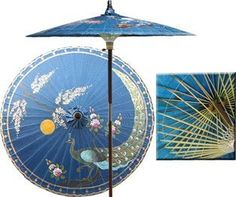 """Victory of the Peacock 7 Foot Patio Umbrella With Base -Blue by Oriental-Decor. $249.95. Masterfully handcrafted and hand-painted with beautiful Asian and floral-themed designs.. The hand-painted umbrella shade is oil-treated for a glossy, water-repellant finish.. Durable frame made from stained oak hardwood.. All patio umbrellas ship with 4-day UPS air.. 1 1/2"""" 2-piece pole fits securely into any standard patio umbrella base or patio table.. Symbolic of beauty ..."""