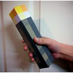 Make your own minecraft torch!  Just put a flashlight in the bottom.