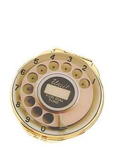 the rotary-dial design of this old-fashioned compact seems to acknowledge, with a wink, that most of us have become accustomed to checking our makeup with our smartphone cameras; the use of a small mirror is, by contrast, simultaneously more discreet and more glamorous.