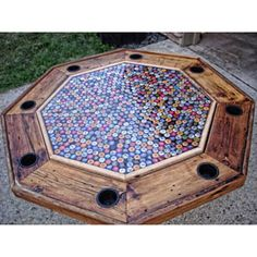 Beer Bottle Cap Poker Table. I need to do this to refinish the poker table!!! Drink up, big boys!