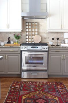 design indulgence: BEFORE AND AFTER Love this backsplash and paint color of the lower cabinets!