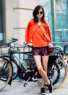 Hanneli Mustaparta - Self-customized vintage shorts (ripped seams at the front), orange twinset, Mulberry bag, and Prada creepers.