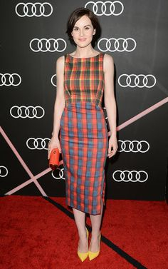 Chic in plaid. Love the mixture of plaid prints on the dress.