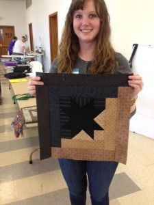 Today at the quilt in a day class I made my 1st Quilt. I think it looks pretty nice. What do you think?