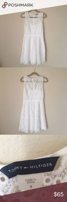 Tommy Hilfiger fit and flare lace white dress Tommy Hilfiger fit and flare lace white dress. This dress features a white slip with a lace overlay. Hidden back zipper. There is a small stain on white slip (see photo), but is not noticeable when wearing. Otherwise excellent condition. Worn once. Flattering floral lace details. Size 8. Stock photo courtesy of Macy's. Tommy Hilfiger Dresses