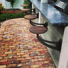 Rugged swing stools for outdoor kitchen. Out of the way when space is needed, convenient seating where you need it.