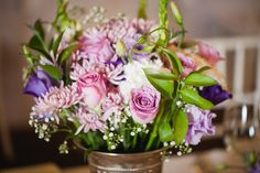 Purple Wedding Table Flowers Photographer: Lauren Kriedemann Venue: Rickety Bridge