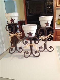 Iron candlesticks and terra cotta pots