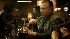 Piney Winston  Piney Winston (William Lucking) was a founding member of the Sons of Anarchy Motorcycle Club, and also the father of Opie (Ryan Hurst), another member of the club. He became progressively more suspicious of Clay (Ron Perlman) and more disenchanted with the club as time went on. When Piney threatened Clay with letters that proved he killed Jax's father, Clay visited Piney at his cabin and killed him. Clay staged it to look like Piney was killed by the Lobos Sonara.