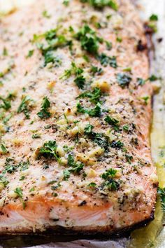 Salmon that is baked in foil and brushed in a Parmesan Garlic Herb Marinade.  It seals in the amazing flavor and cooks the salmon to tender and flaky perfection!  A couple of weeks ago I had the ho…