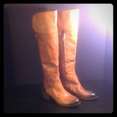 Vince Camuto leather Boots size 7.5  NWOT These are beautiful boots.  The black coloring on the boots are a little different a little leather paint can easily fix this.  These boots have never been worn. Vince Camuto Shoes Over the Knee Boots
