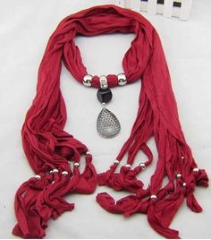 Beautiful red jewellery scarf with tear-drop pendant.