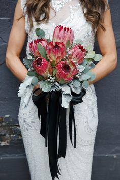 protea bouquet with ribbons Floral: Blush & Bloom Photography: Mango studios Bouquet Bride, Protea Bouquet, Bridesmaid Bouquet, Bouquet Toss, Modern Wedding Flowers, Bridal Flowers, Floral Wedding, Protea Wedding, Wedding Bouquets