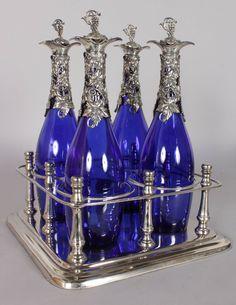 Set de 4 decanters com topos em silver plated,