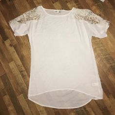 Sheer white tunic Sheer white tunic with lace detail on sleeves. Never been worn. Cato Tops Blouses
