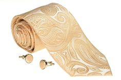 Gold paisley tie. Also available with matching cufflinks. On sale $35.