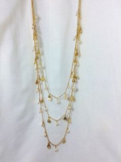 Gold Feather & Pearl Necklace and Earring Set via aladyloves.com