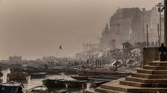 Felipe de Castro Horta Hoffmann Martins - Ganges River. Mornings on the River Ganges are often covered with a haze that melts with pollution. The chaos of the landscape inspires the most varied photographs. Varanasi (city) is a world of history, where the sacred is always in evidence. The photo features a daily scene in India's holiest site