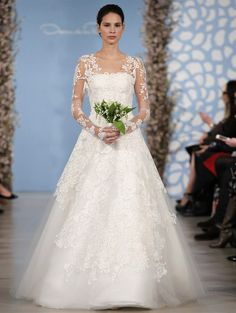 Wedding dress by Oscar de la Renta from his Spring 2014 bridal collection | via junebugweddings.com