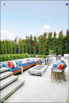 Cottage outdoor patio space furnished with a teak outdoor sectional accented with blue and orange accent pillows. Outdoor Console Table, Fire Pit Gallery, Outdoor Spaces, Outdoor Decor, Outdoor Kitchens, Outdoor Living, Concrete Fire Pits, Pergola Pictures, Pergola Designs
