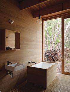 Australian master bath with wood tub and Ikea sink
