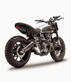 "Cool Ducati Scrambler Dirt Tracker built by Gessato. They made the Scrambler look a bit more aggressive and ""dirty"". Moto Scrambler, Ducati Scrambler Custom, Ducati Motorcycles, Custom Motorcycles, Custom Bikes, Cars And Motorcycles, Moto Ducati, Yamaha, Cafe Racer"