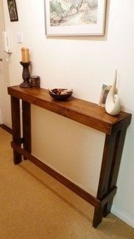 Recycled Pallet furniture. Take a regular old pallet, break off the pieces you don't want, varnish and VOILA! A cool side table for a wall somewhere!