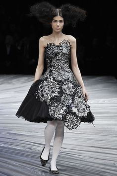 Alexander McQueen, F08.  Again, totally not white, but interesting asymmetry and use of over/under.