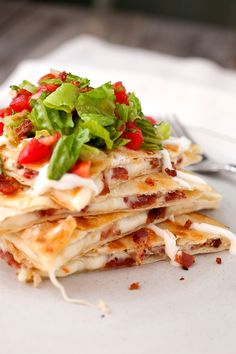 BLT Quesadillas: Simple quesadillas filled with crispy bacon and spicy pepper jack cheese and topped with a light and fresh tomato salad! | macheesmo.com