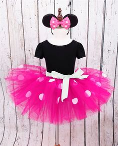 This adorable Minnie Mouse Tutu dress is perfect for your trip to Disney or your little one's birthday party! This dress has a t-shirt top sewn onto 5 layers of tulle for a big skirt. The tulle has wh