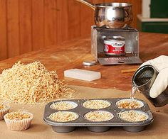 First-rate fire starters- Pack sawdust into paper muffin cups, above, or a cardboard egg carton. Melt paraffin wax or old candles in a double boiler, pour over the sawdust and allow to cool. Slow-burning when lit, these hotcakes make great starters for a fireplace or campfire.