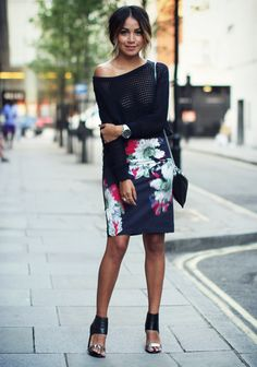 Julie Sarinana is wearing a black mesh top and floral skirt