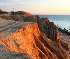 Montauk, NY, A thin ribbon of beach trails along Long Island's southern shore, ending in a rocky precipice at the Montauk Point Lighthouse.