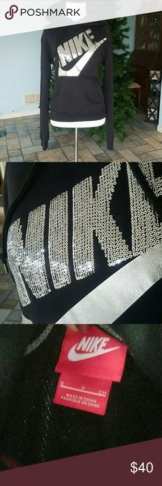 Nike sequin hoodie Black nike hoodie silver check and silver sequin nike on front. Nike Tops Sweatshirts & Hoodies