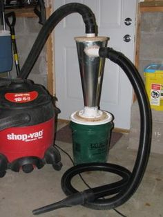 Here's my homemade dust collector that works like a dyson vacuum.  The air comes in the side and the dust falls into the bucket.  The idea came from LumberJocks.com.