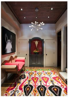 "Can you get more fun and playful than this?!! The rug is insanely gorgeous way to say ""Hey, welcome to how awesome my home is,"" and that whimsical fixture of flying lightbulbs says, ""I'm not too serious."" Great first impression if I do say so myself.   Liz Cann Interiors"