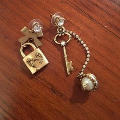 Stunning Betsey Johnson locket and key earrings Stunning locket and key Betsey Johnson earrings. Never worn and in perfect condition!! Betsey Johnson Jewelry Earrings