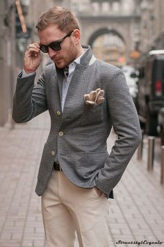 Perfect the smart casual look in a grey wool blazer and beige chinos.  Shop this look for $248:  http://lookastic.com/men/looks/sunglasses-gloves-longsleeve-shirt-blazer-belt-chinos/4282  — Dark Brown Sunglasses  — Beige Leather Gloves  — Light Blue Longsleeve Shirt  — Grey Wool Blazer  — Dark Brown Leather Belt  — Beige Chinos