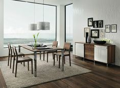 Dark walnut white dining furniture - Chrome plated legs give extra shine and modernism to the warm wood tones, bringing the traditional material bang up to date.