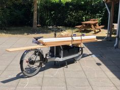 Moving loooong wood pieces through town, while everybody seems to be on vacation :-) Cargo Bike, Wood Pieces, Larry, Vacation, Vacations, Holiday, Holidays