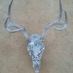 Taking orders now for Christmas. Hand embellished deer skull. Individually applied rhinestones, pearls, natural stones, beads and more plus it's customized to your preference in color.