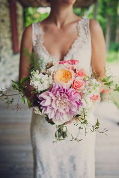 lush wedding bouquet // photo by Khaki Bedford, flowers by Foxglove Floral Design // http://ruffledblog.com/diy-mount-guilan-wedding #dahlias #weddingbouquets