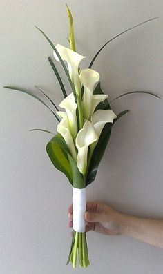 Contemporary Arranged Bridal Bouquet, Probably An Arm Sheaf, Of Large White Calla Lilies & Beautiful Emerald Foliage··································