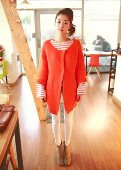 orange color cardigan and white pants.  stripe tee