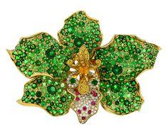Isis - Orchid brooch/wrist cuff with tsavorite garnet, yellow sapphire, pink sapphire, and diamond by Paula Crevoshay. Photo by Chris Chavez.