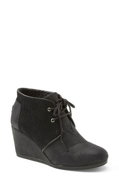 Free shipping and returns on TOMS 'Desert' Wedge Bootie (Women) at Nordstrom.com. A mix of textures adds rich contrast to a suede bootie laced with utilitarian undertones. Lifted by a just-right wedge, this versatile style features signature asymmetrical toe detail, soft cotton lining and a cushy sole.