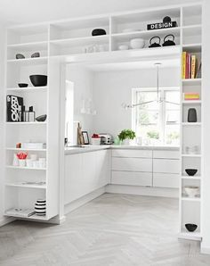 This could be the shape of the upstairs kitchen if you steal some space. Even some shelves surrounding the opening you could put a collection of all white serving pieces up top and a mix of other below.