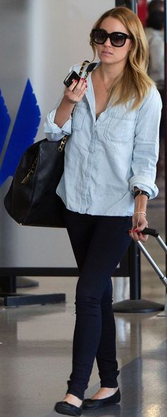 Lauren Conrad : Emmanuelle Khanh paris black sunglasses, denim shirt, Vintage oversized Chanel bag, dark skinny jeans & flats chambray shirt